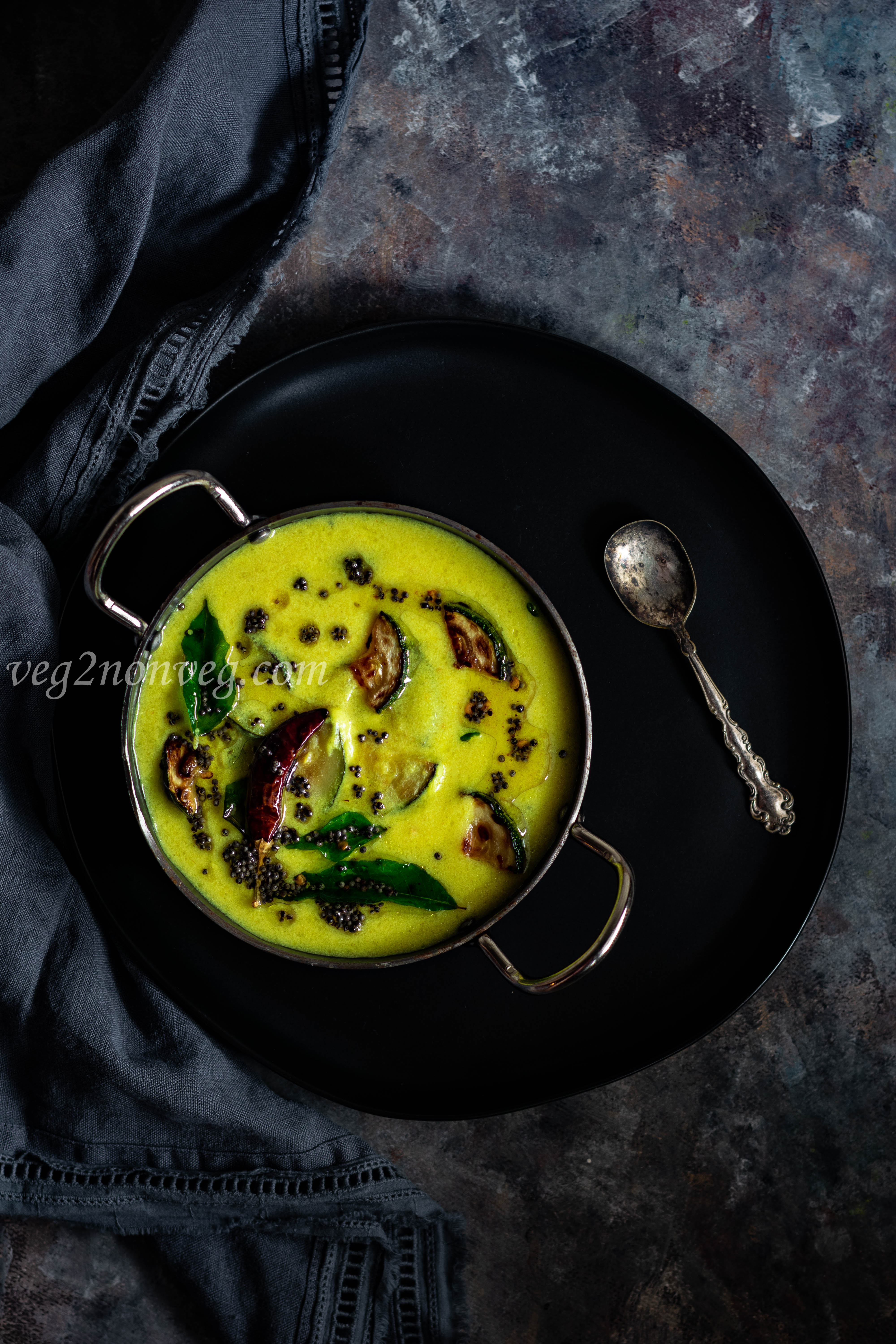 Zucchini in yogurt and coconut based curry (Zucchini Mor Kuzhambu)