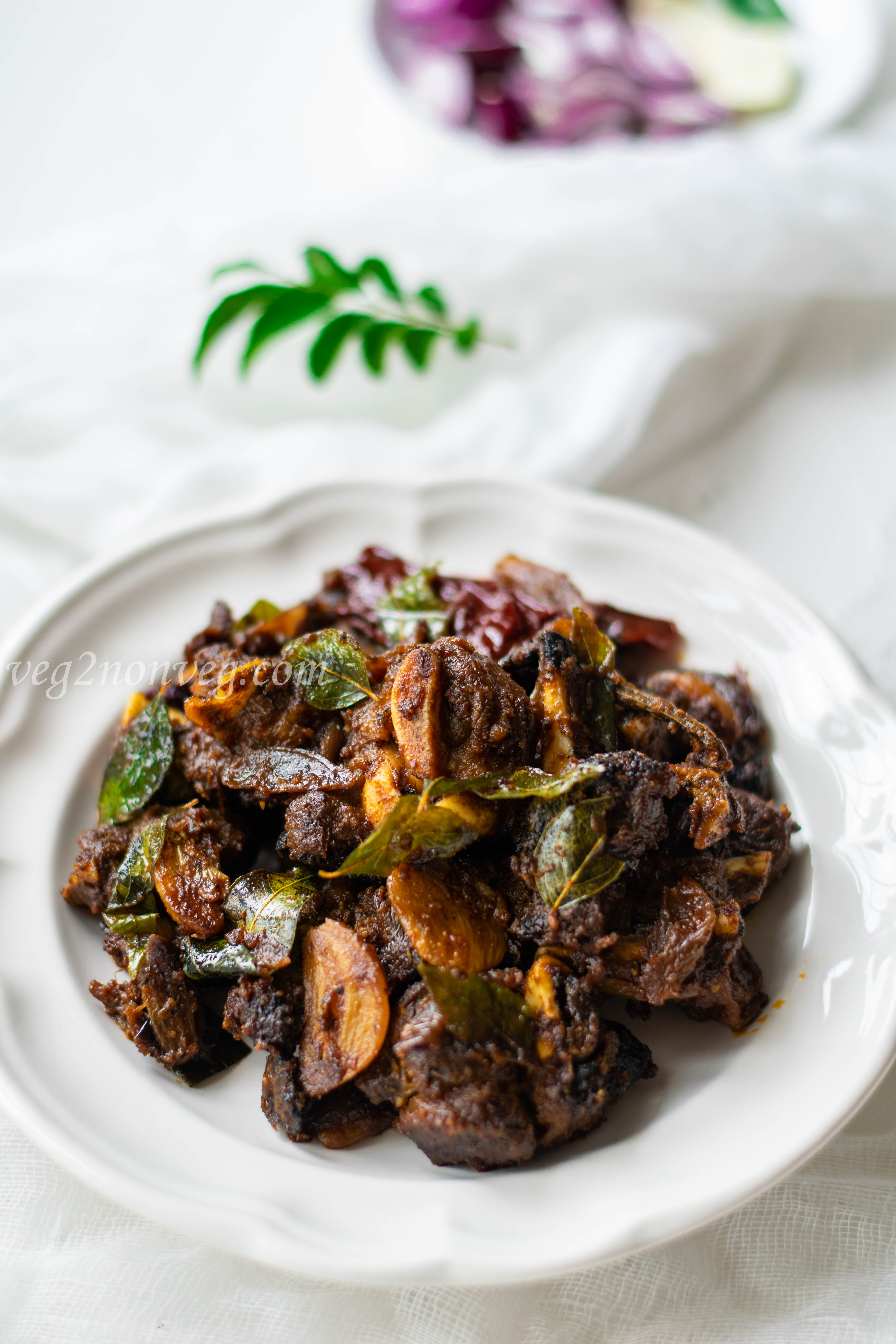Indian spicy goat fry (Chettinad mutton chukka varuval)