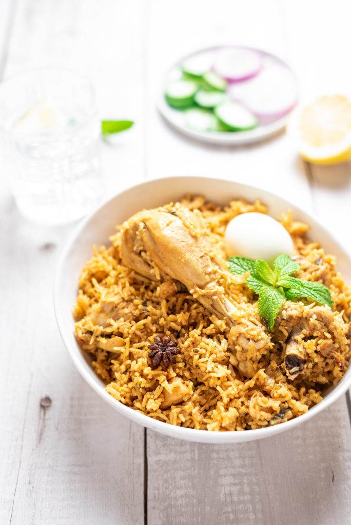 Chettinad chicken biryani, chicken biryani recipe, chettinad cuisine, chettinad recipes, non-vegetarian dishes, karaikudi biryani, kozhi biryani, chettinad biryani in tamil, biryani food styling, biryani photography, Indian food photography, best biryani recipe, quick and easy instant pot chicken biryani